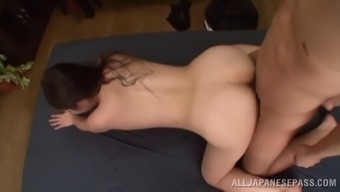 Wonderful Japanese cougar moaning while her pussy is licked in the kitchen