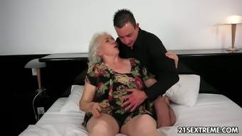 Young man plays with saggy tits of one sex-hungry granny