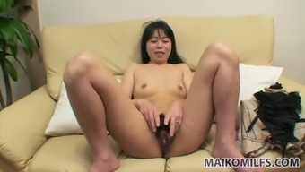 Yasuko Haraguchi thinks of pleasing her pussy with small dildo