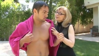 Nina Hartley looks like a librarian with her glasses on but while wearing