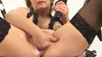Mature Rieky oiled pussy fingered seductively in BDSM