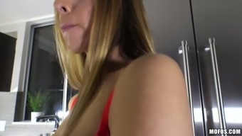 Gorgeous fair haired bombshell swallows stiff penis of her guy at kitchen