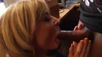 Nina Hartley Sucks And Strokes Cock In The Office