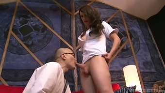 Bald headed submissive doctor provides nasty shemale nurse with blowjob