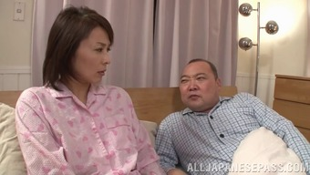 Short haired Asian wife fingers herself while her hubby sleeps