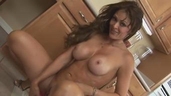 Fake-tit brunette Monique Fuentes is posing