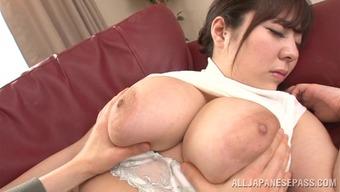 Wonderful Asian milf with big tits giving a steamy handjob