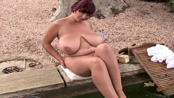 Chubby mom gets naked and shows off her goods outdoors