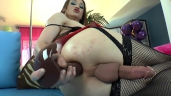 Shemale Jacqueline Woods is wanking a cock