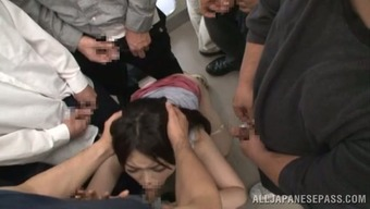 Japanese chick sucks cocks in a bus and gets cum on her big boobs
