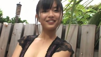 Raven haired Asian cutie Mayumi Yamanaka likes webcam in the shower