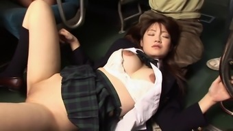 Japanese babes shaved pussy is getting pounded by a gourp of guys