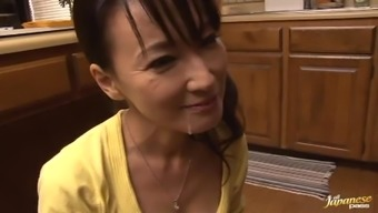 Gorgeous Mature Japanese Giving an Awesome Blowjob in the Kitchen