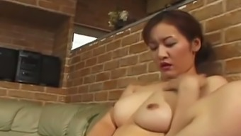 All nude MILF Reiko Kamiya tickles her own pussy and wanks strong cock