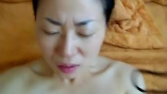 Asian big belly Korean slut rides a hot cock so hard