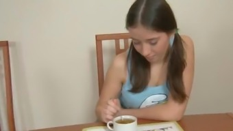 A pigtailed Russian teen gets banged in a dining room