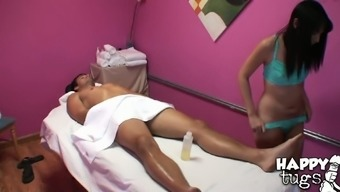 Perverted masseuse gives massage and jerks off oiled up cock