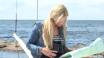 Lovely tanned blonde Lindsey B is masturbating her pussy on the yacht