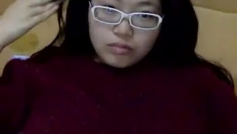shy chinese girl shows face (would you)
