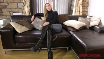 Thigh high boots and a sexy turtleneck on a milf goddess