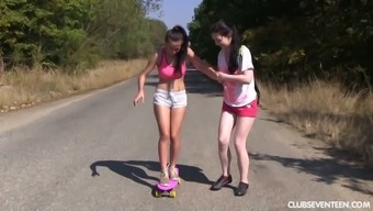 Two captivating teens are licking each others pussies by the roadside