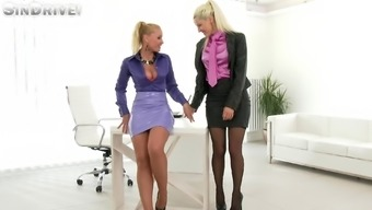 Hot co-working sluts eat some pussy on a desk in the office