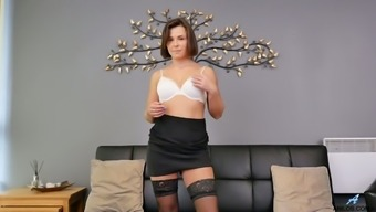 Sexy secretary Jamie Ray is relaxing and masturbating on the couch