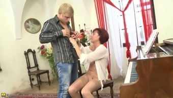 Mature piano teacher seduces her good looking student