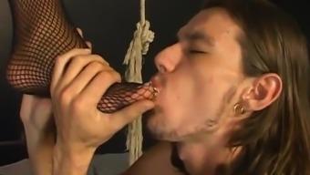 Horny male sex slave licking slut's feet before she gives footjob