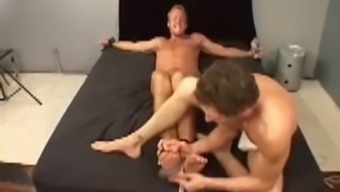 Brett laughs uncontrollably while being tickled by Chip