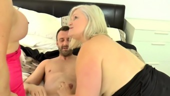 Granny rides cock and face in threeway
