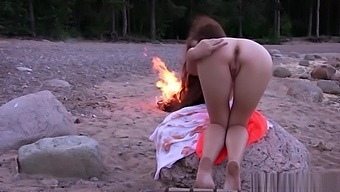 Night's Beach. Young and beautiful Norma A touches her pussy near a bonfire