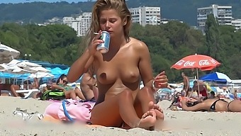 Fine looking topless girl at the beach