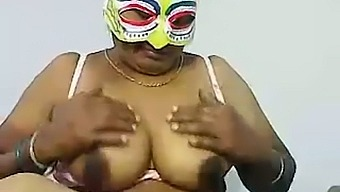 Chubby dark skinned webcam masked Desi whore plays with boobies