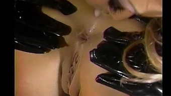 Lesbians in latex Jenna Jameson and Jill Kelly play with each other