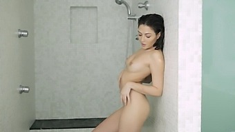 Solo chick Cassie Lane takes a shower and plays with her clit